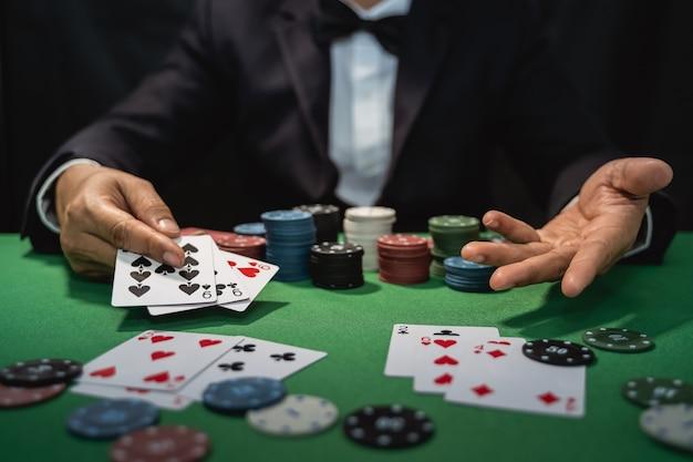 Dealer shuffles poker cards in a casino