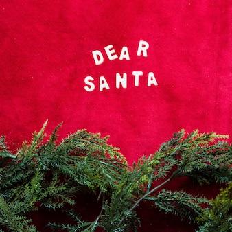 Dear santa title between green coniferous branches