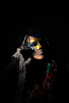 The death. artistic makeup representing death in a carnival costume play,