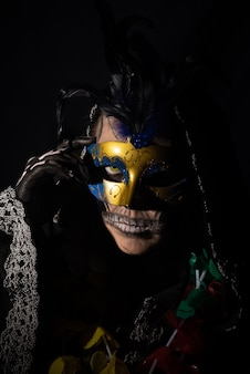 The death. artistic makeup representing death in a carnival costume play
