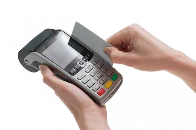 Debit card swiping through pos terminal in woman hands isolated on a white background