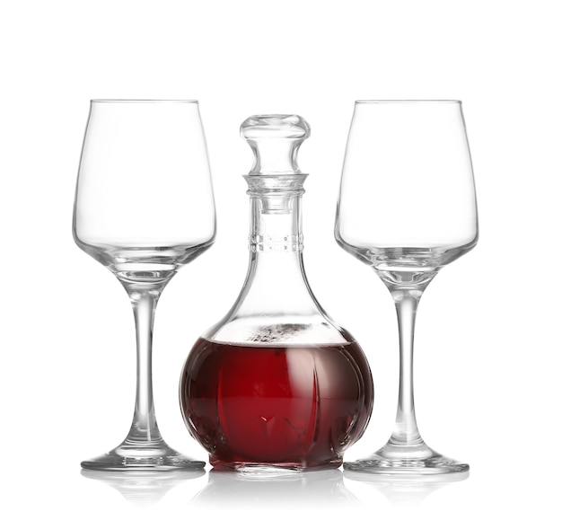 Decanter of wine and glasses isolated