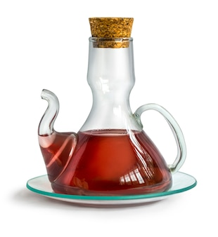 Decanter with wine vinegar isolated on the white