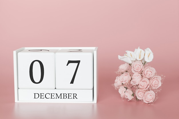 December 07th. day 7 of month. calendar cube on modern pink background, concept of bussines and an importent event.