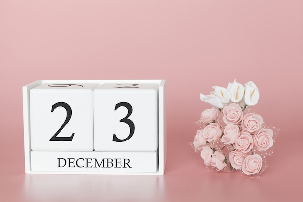 December 23rd. day 23 of month. calendar cube on modern pink background, concept of bussines and an importent event.