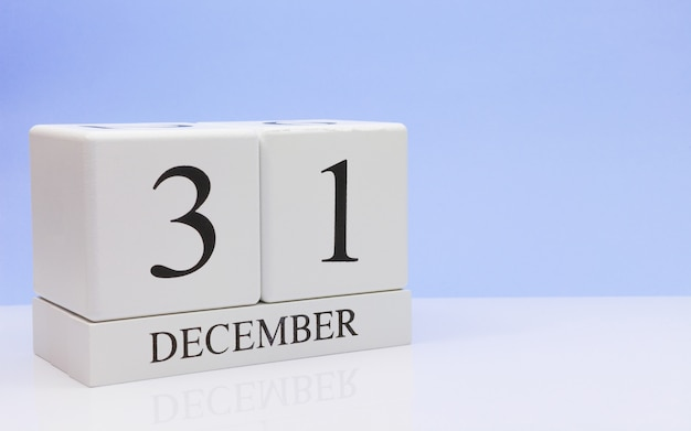 December 31st. day 31 of month, daily calendar on white table.