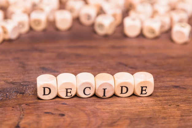 Decide text written on wooden dice