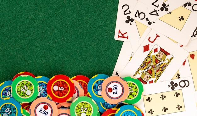 Deck cards on casino table with betting chips