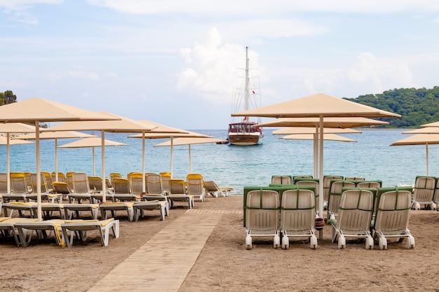 Deck chairs on beach kemer, turkey.