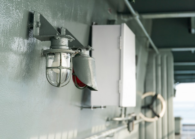 Deck lamp on ship in protective cage