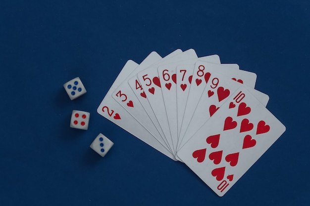 A deck of playing cards and dice on classic blue.