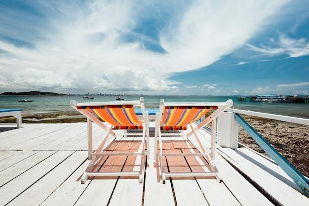 Deckchair at coast of sea