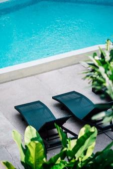 Deckchair at swimming pool