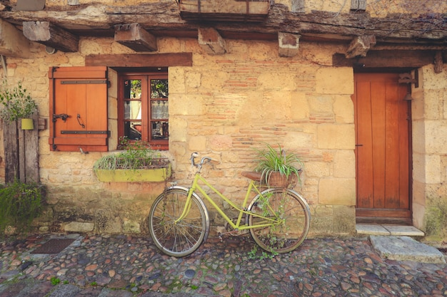 Decoloration bicycle park in front entrance door of tradition stone house in bergerac town, france