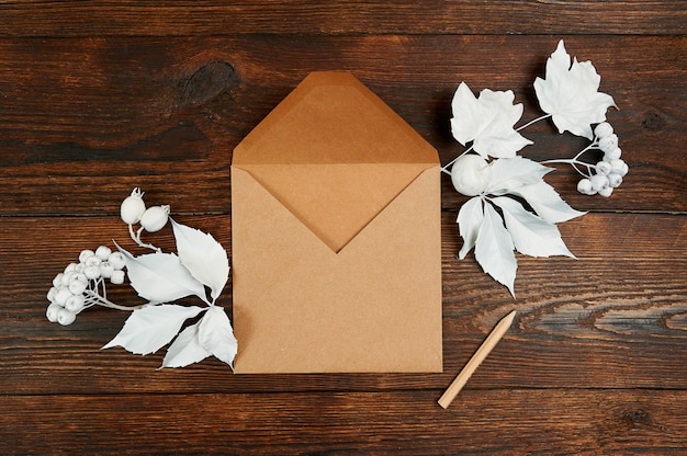 Decor autumn composition with kraft envelope and pencil