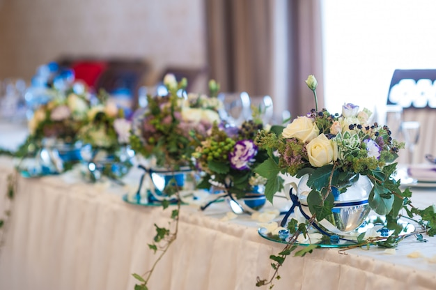 Decor of flowers on wedding table bride and groom