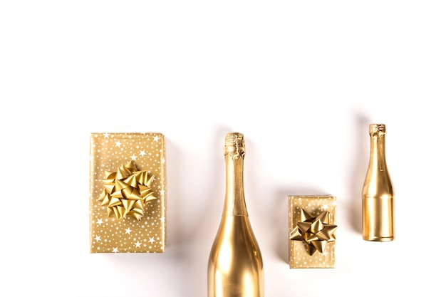 Decorated bottle of golden champagne.symbol of christmas