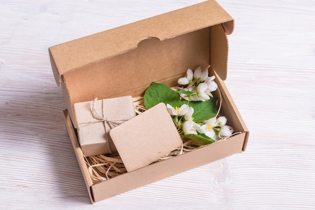 Decorated cardboard gift box on wooden table