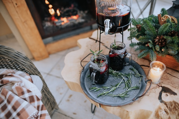 Decorated christmas table with a glass of mulled wine