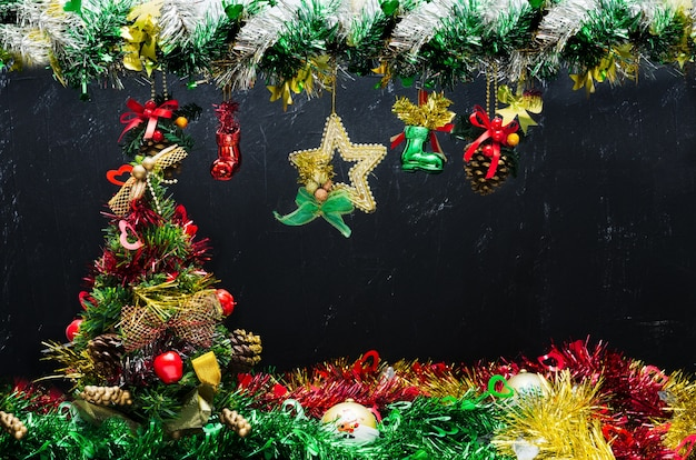 Decorated christmas tree on blackborad background.