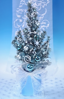 Decorated christmas tree on blue