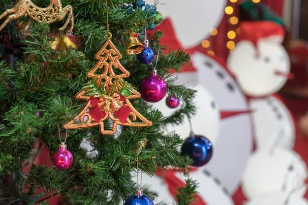 Decorated christmas tree on blurred background