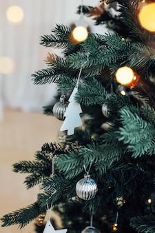 Decorated christmas tree, minimalist scandinavian decor backgrou