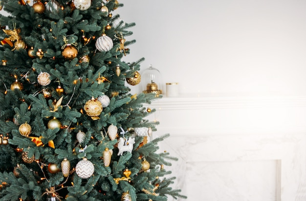 Decorated christmas tree with gifts in bright living room, scandinavian interior, place for text