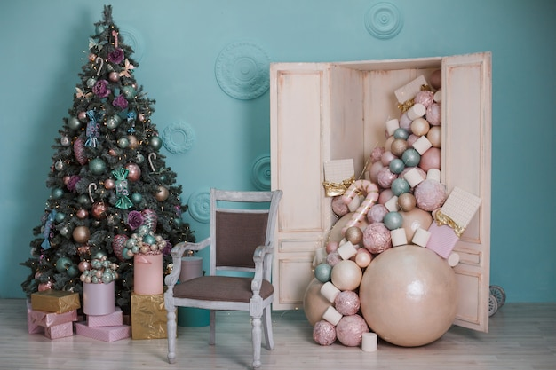 Decorated christmas tree with gifts. easy chair