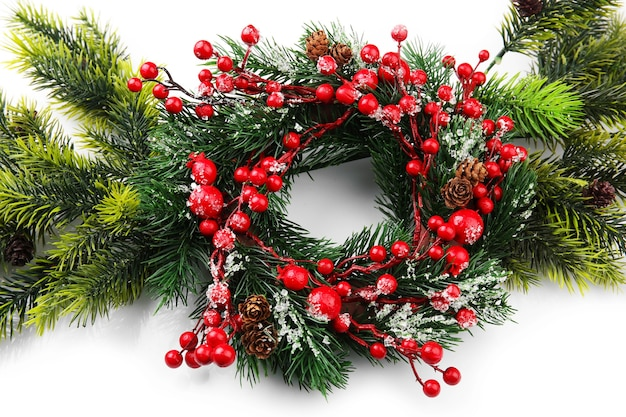 Decorated christmas wreath on white background