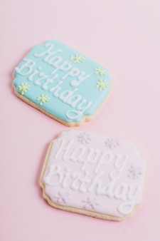 Decorated cookies with happy birthday text