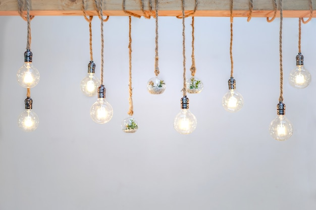 Decorated cozy lamps stick in the rope and little tiny tree with small white rock inside