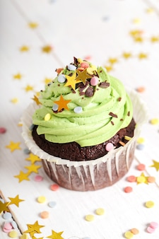 Decorated cupcake with sprinkles and stars