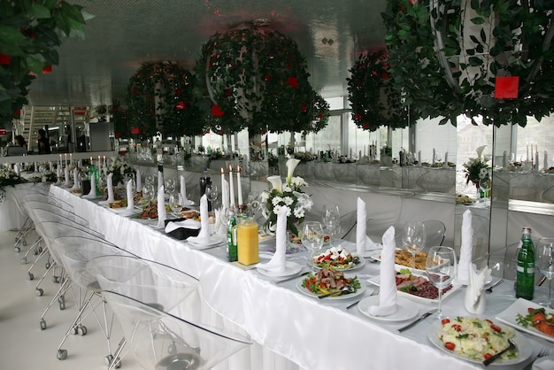 Decorated festive banquet with the food in the restaurant