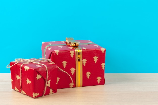Decorated gift boxes on light blue background