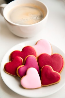 Decorated heart shaped cookies on white