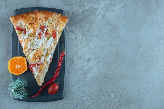 A decorated lunch serving of pizza on marble surface