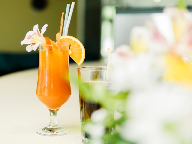 Decorated summer cocktail in bar