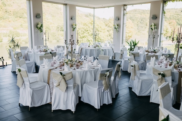 Decorated tables in light tones at wedding at a restaurant