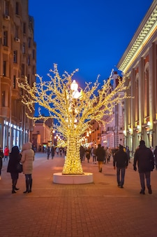 Decorated tree on old arbat, christmas decoration in center of moscow