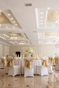 Decorated wedding banquet hall in classic style.