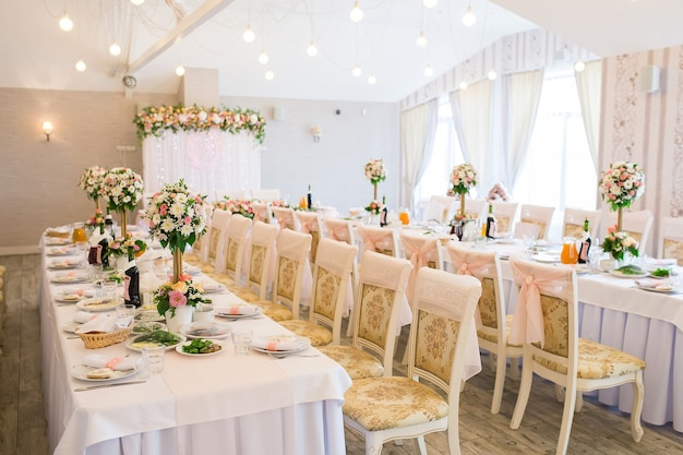 Decorated wedding banquet hall with served tables