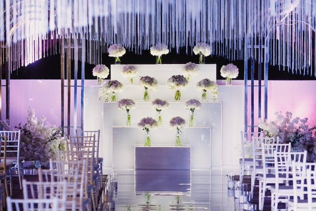 Decorated wedding ceremony venue in white and purple