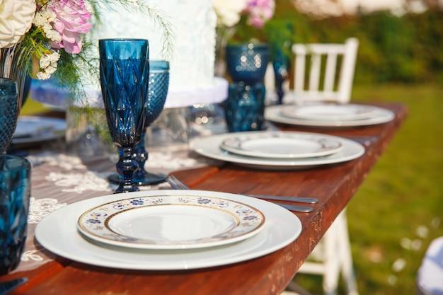 Decorated for wedding elegant dinner table in garden
