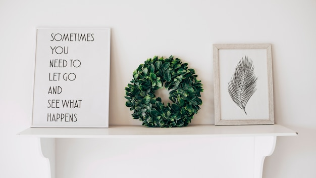 Decorated with picture quote and wreath shelf