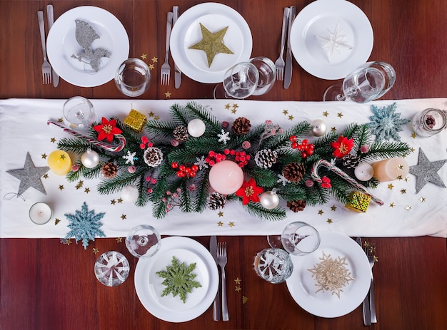 Decorates a christmas arrangement with candles. christmas decor for table wear.