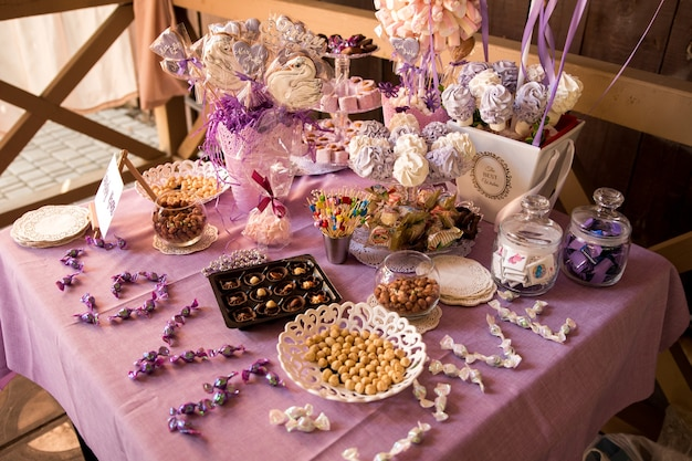 Decorating the festive table. the table is decorated with a purple tablecloth.
