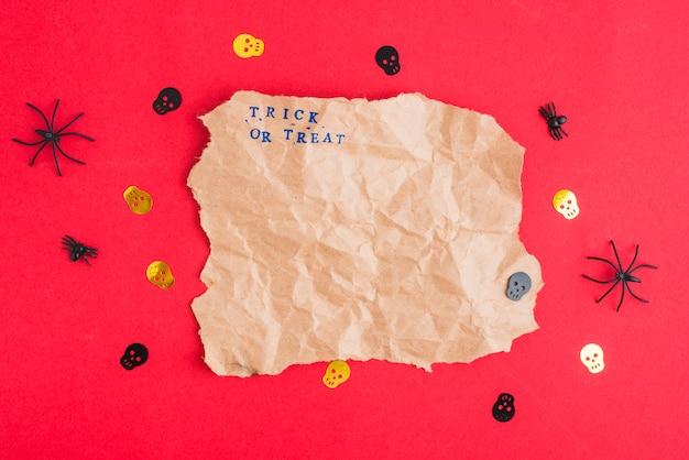Decorating skulls and spiders around craft paper