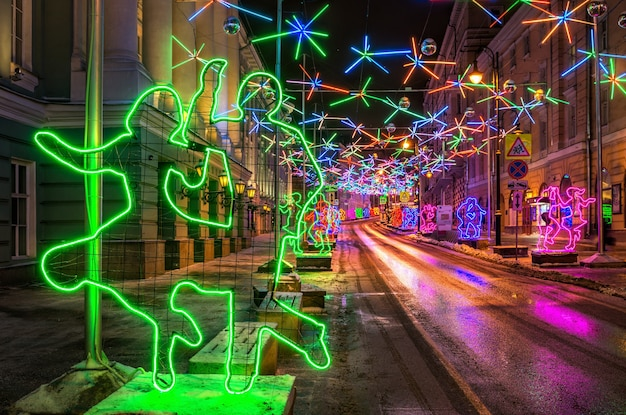 Decorating of the street in moscow in the form of dancing people