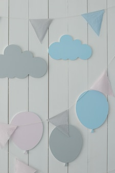 Decoration for baby room kid holiday white wall is decorated with garland of flags